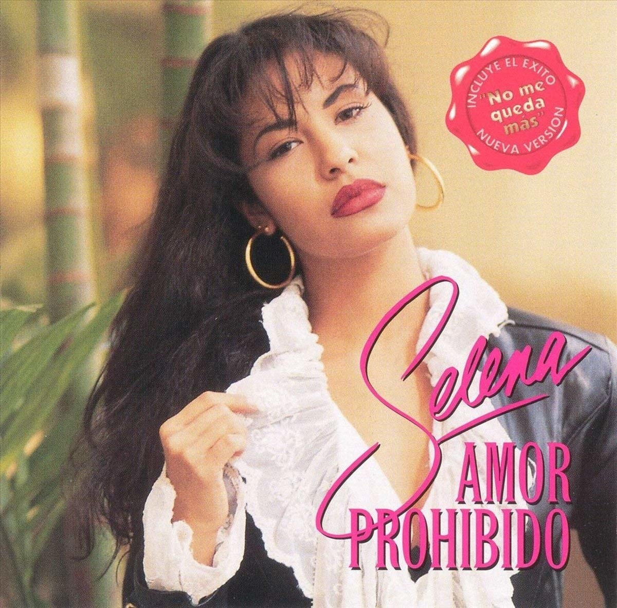 The classic cover of Selena's Amor Prohbido album which features her titling her head to the side, while wearing hoop earnings, a ruffled collar blouse, and black leather jacket