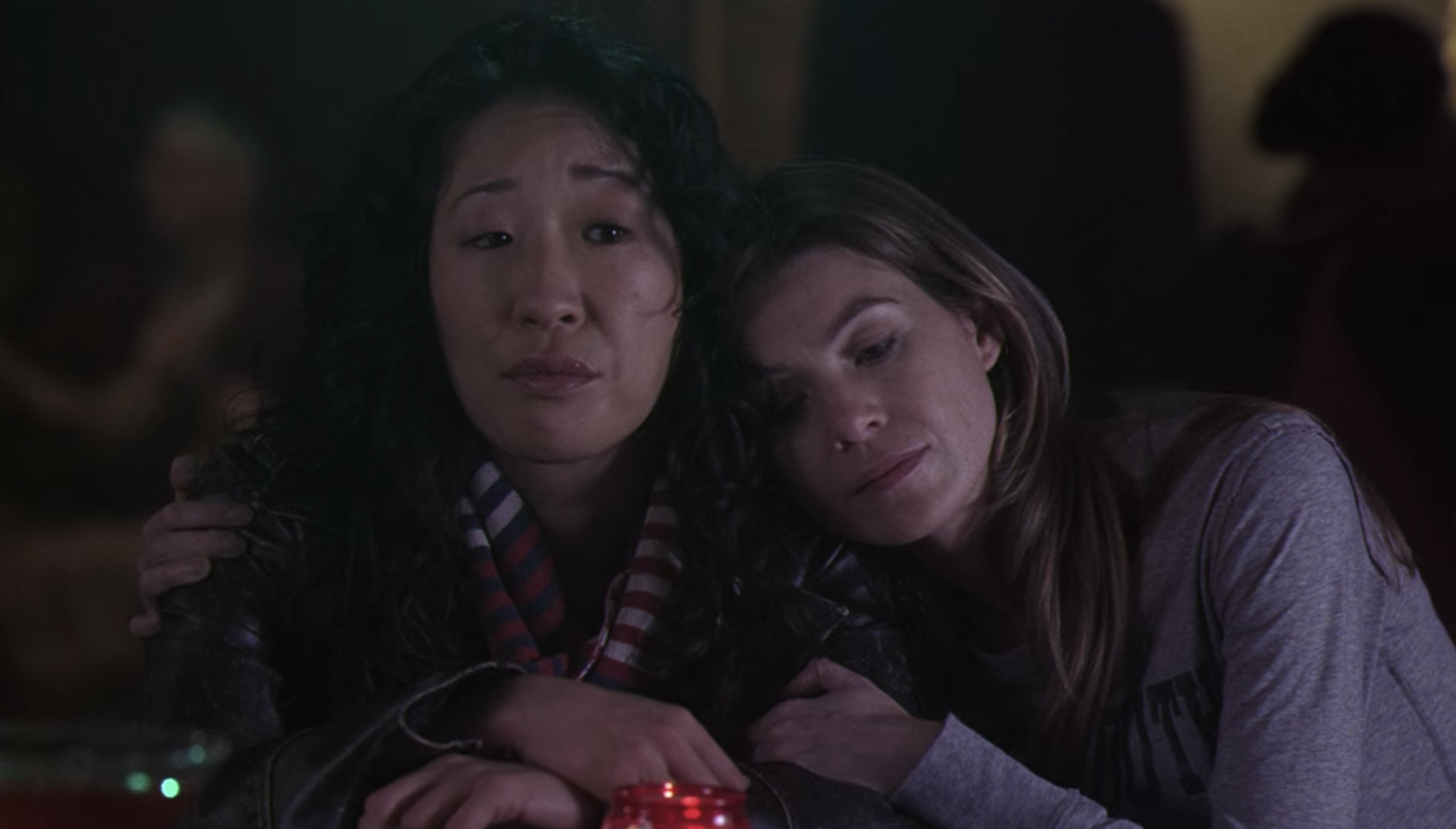Cristina and Meredith hugging in a bar