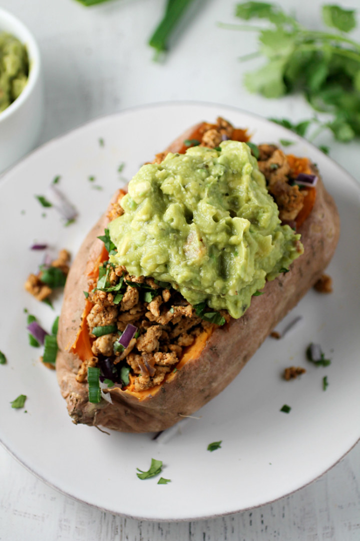 A roasted sweet potato stuffed with ground turkey, peppers, cilantro, and avocado.