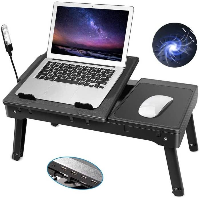 the black laptop desk tray  with a close-up of four USB ports