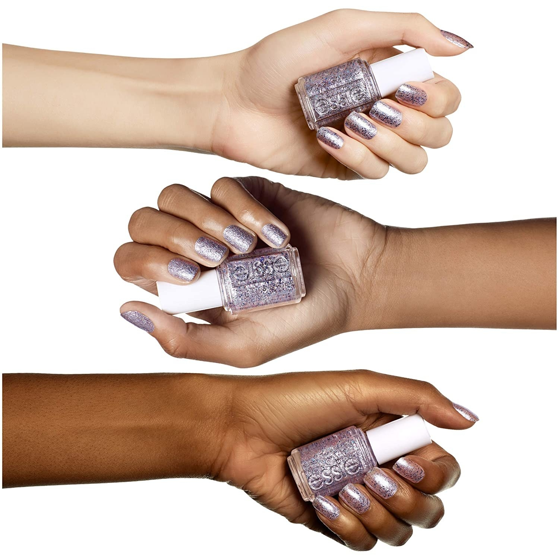 Three hands holding the nail polish bottle and wearing the nail polish