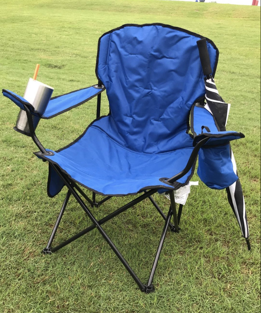Blue foldable camping chair in the grass