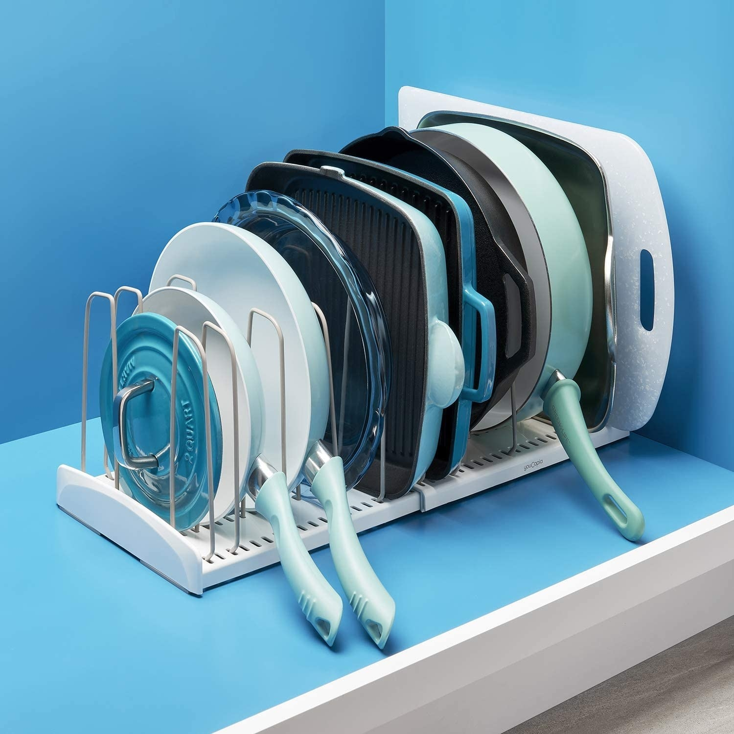 The expandable cookware organizer laden with tons of pots and pans