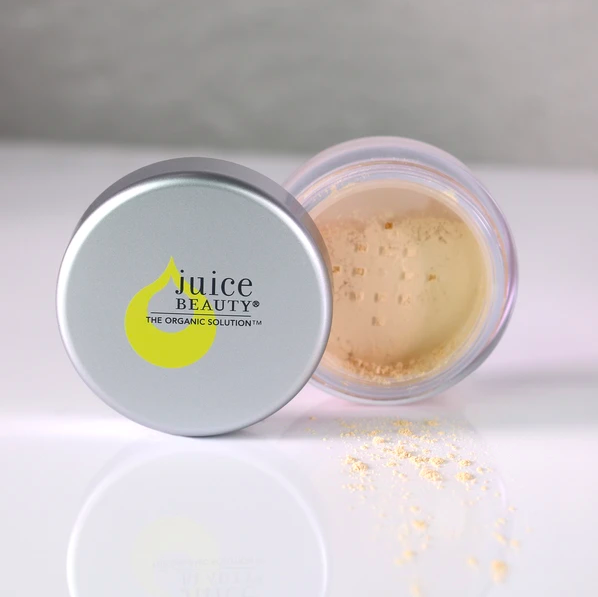 A tin of Juice Beauty blemish-clearing powder
