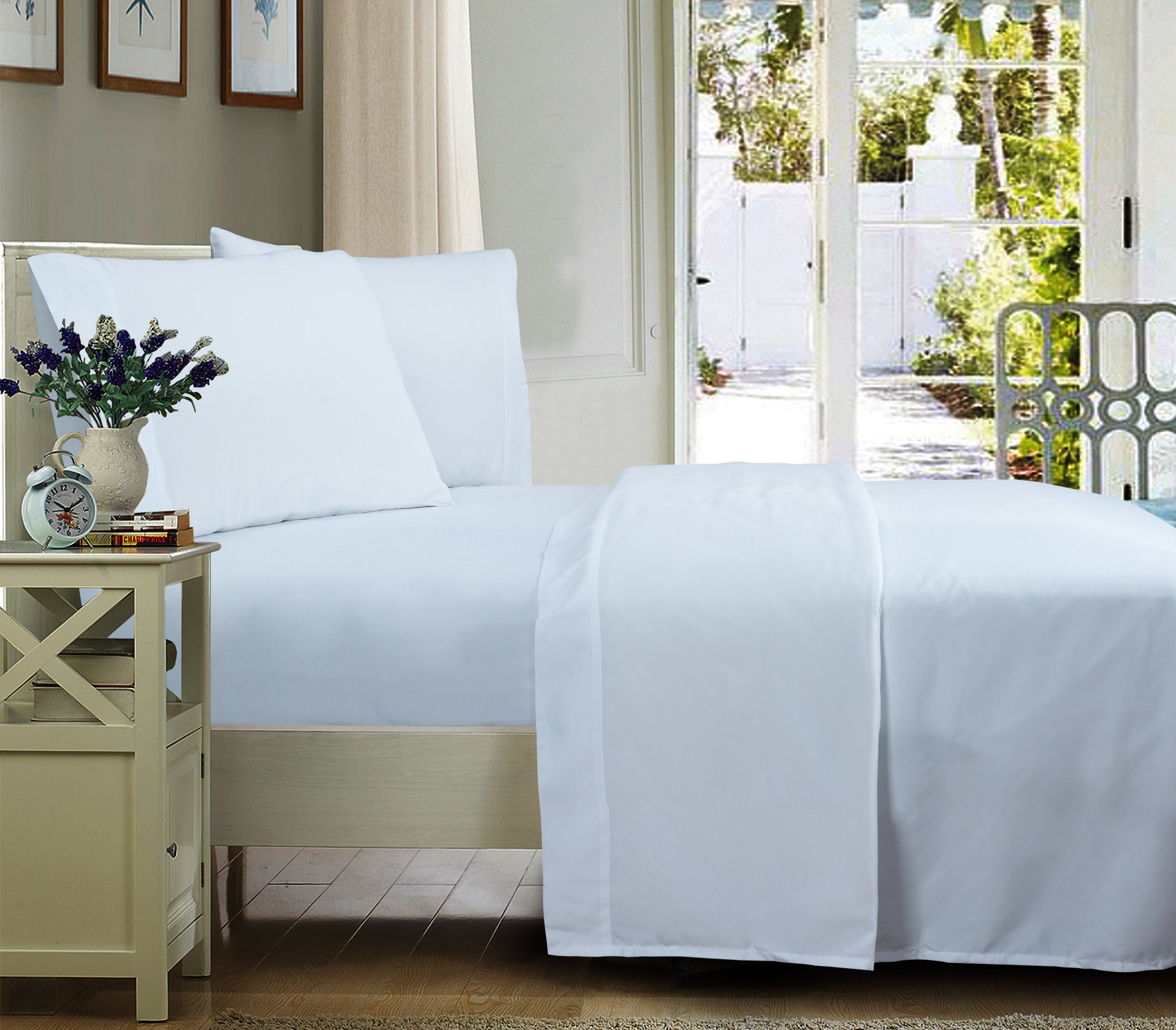 The sheet sets in arctic white on a bed