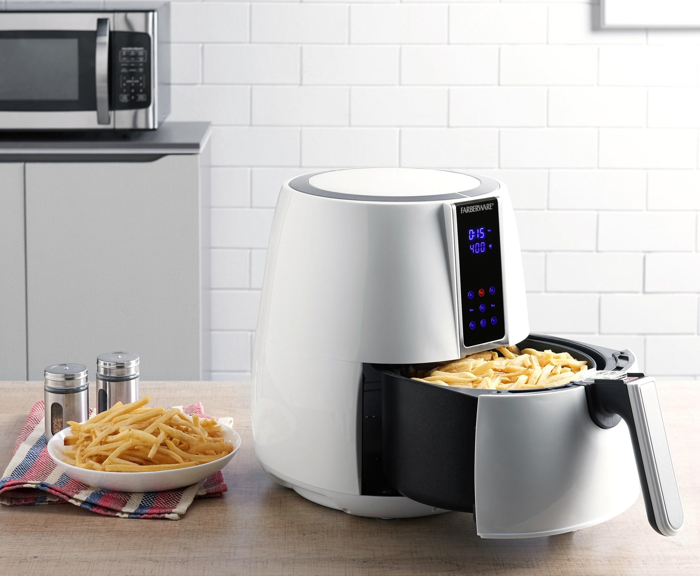 The air fryer in white making french fries