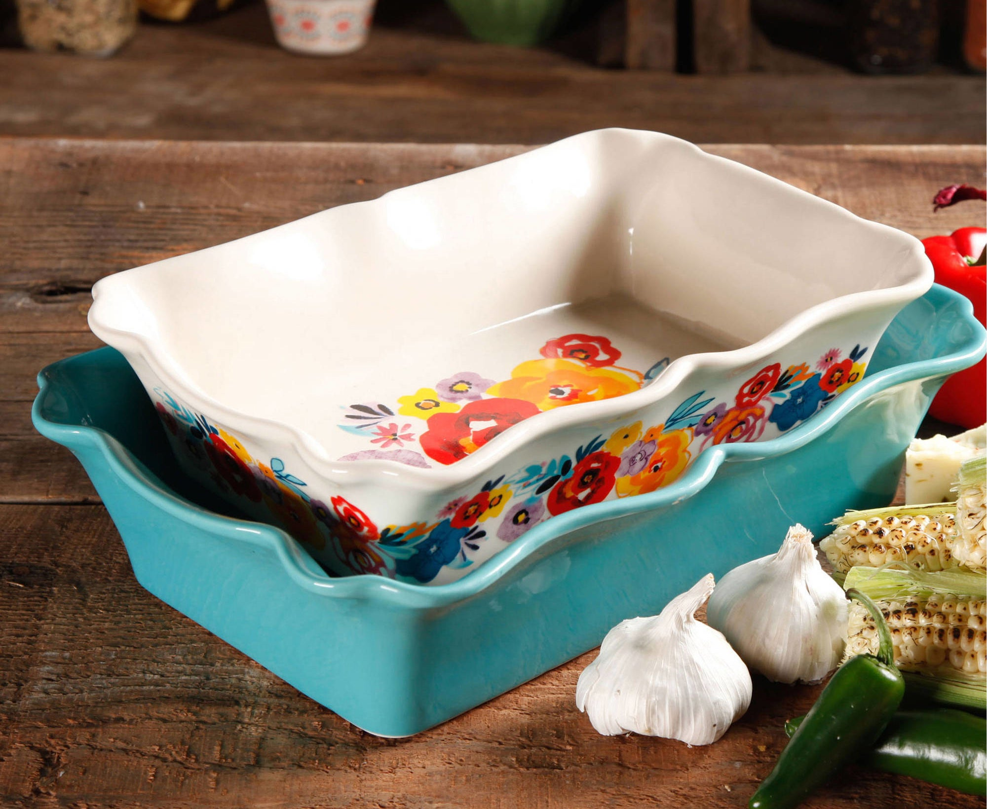 The bakeware set — one is turquoise and the other is white and floral