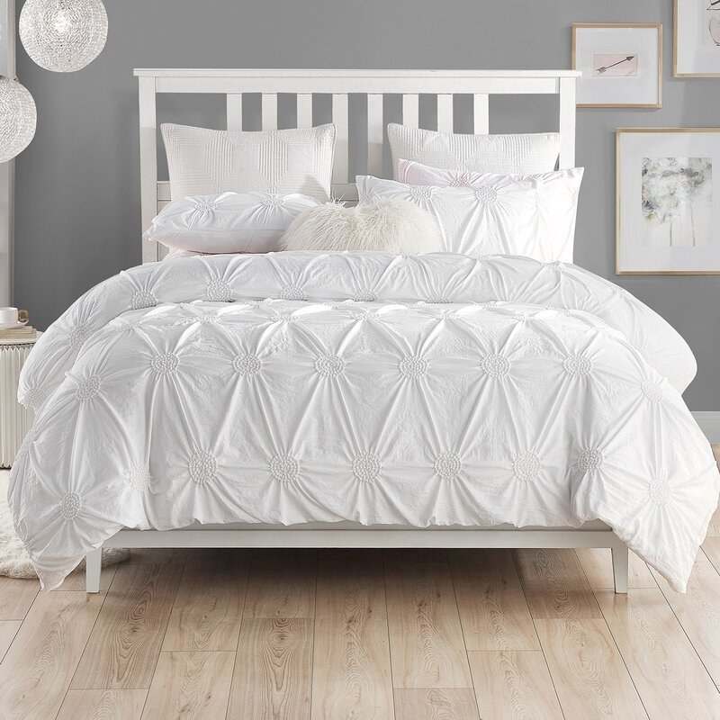 Cathay Home's Ruched Pintuck Rosette duvet set in white with matching shams