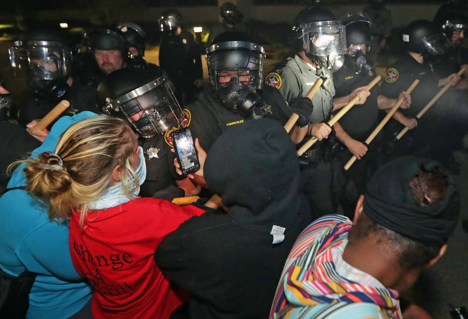 Police use batons to push back a crowd