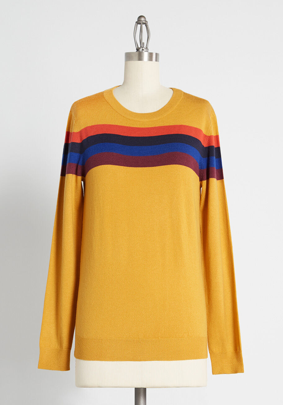 The long-sleeved sweater with ribbed edges, scoop neck in yellow with orange, black, blue, and brown stripe across the shoulders and chest