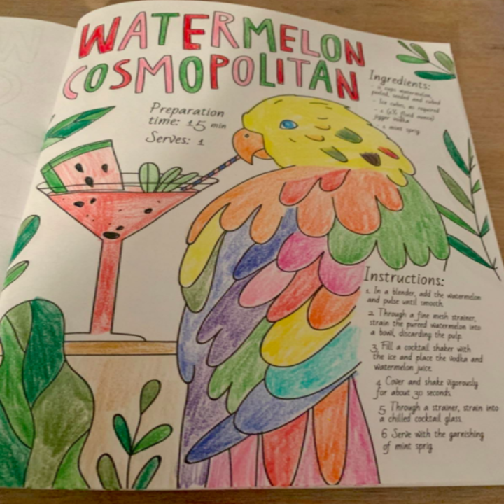 """Reviewer shows colored-in page that says """"Watermelon Cosmopolitan"""" with a recipe"""