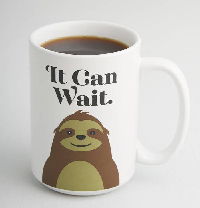 "White mug featuring a cute sloth graphic and the words ""It Can Wait"""