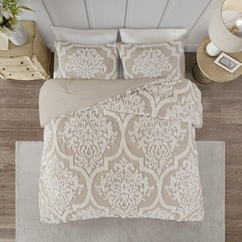 Elder & Ivory's chenille comforter set with a taupe color and lighter beige damask design