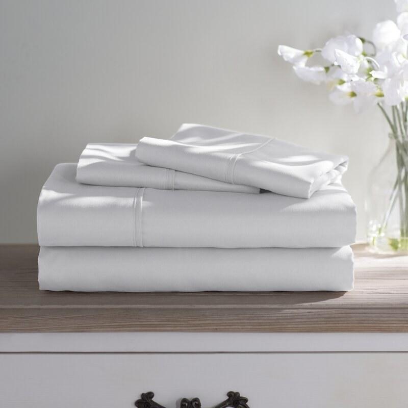 A stack of Wayfair Basics 1800 Series sheet set in white