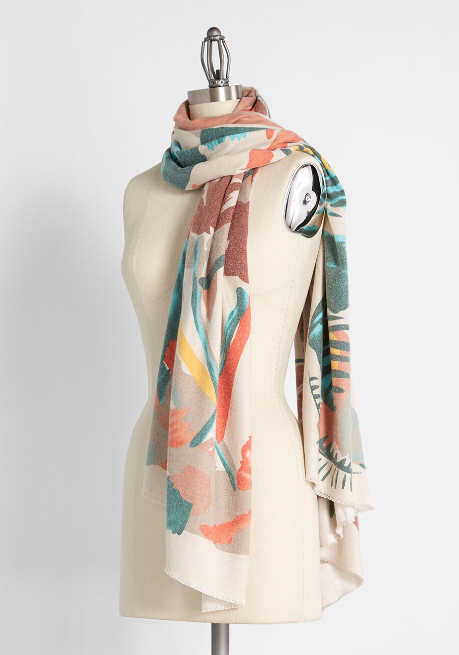 Beige scarf with orange, yellow, brown, and green floral-print pattern all over it