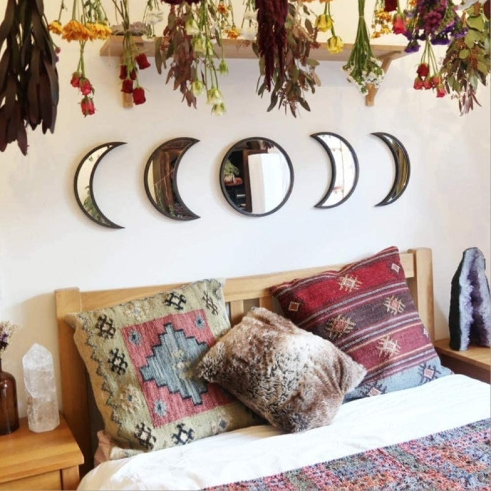 Five stick-on wall mirrors in growing crescent moon shapes on either side. Circular mirror in middle.