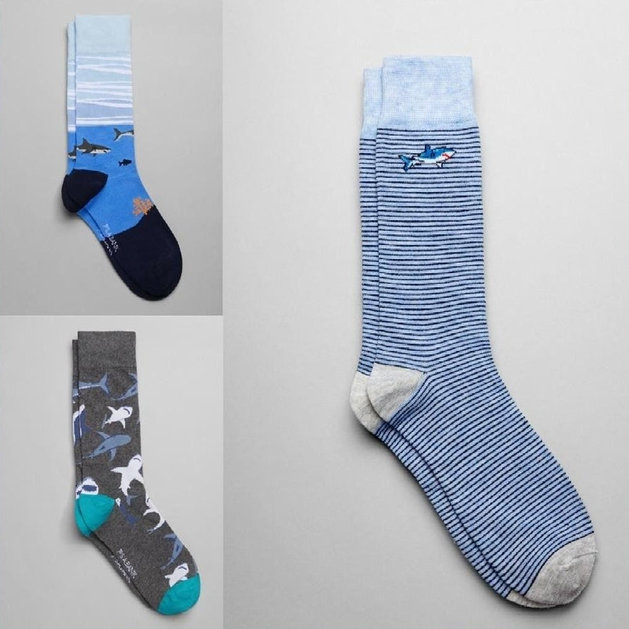 Three pairs of mid-calf socks featuring shark designs
