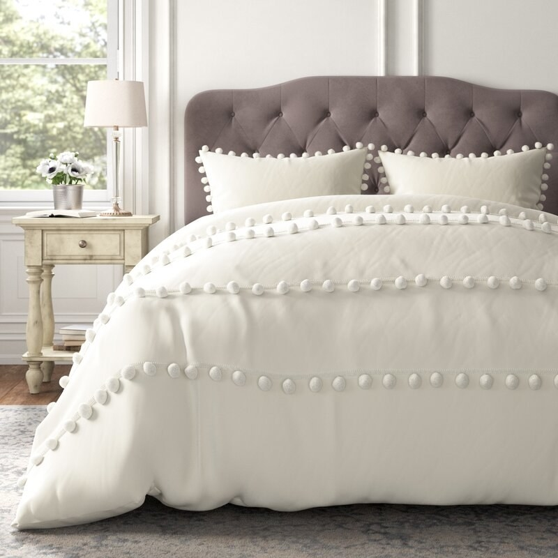 Kelly Clarkson Home's Montgomery pom pom cover in ivory