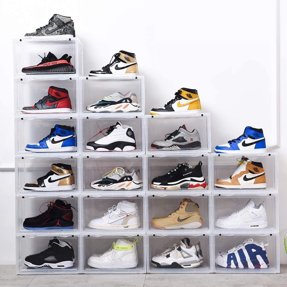 Transparent shoe boxes neatly stacked and containing clean sneakers