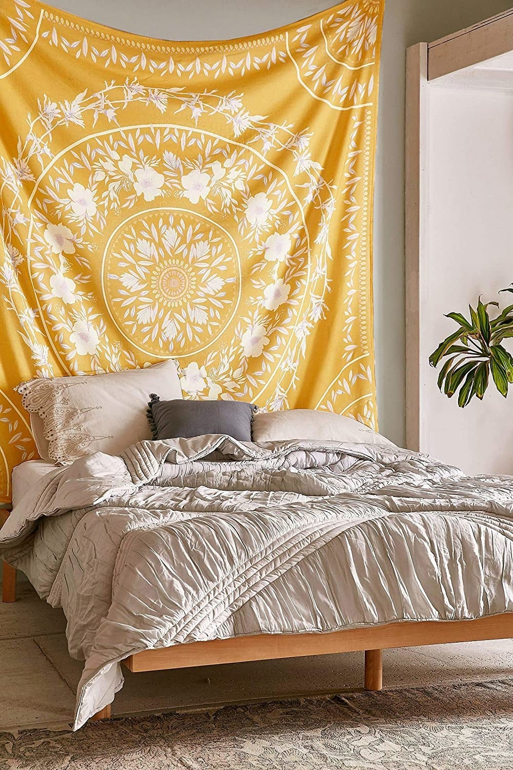 Large yellow tapestry with floral pattern