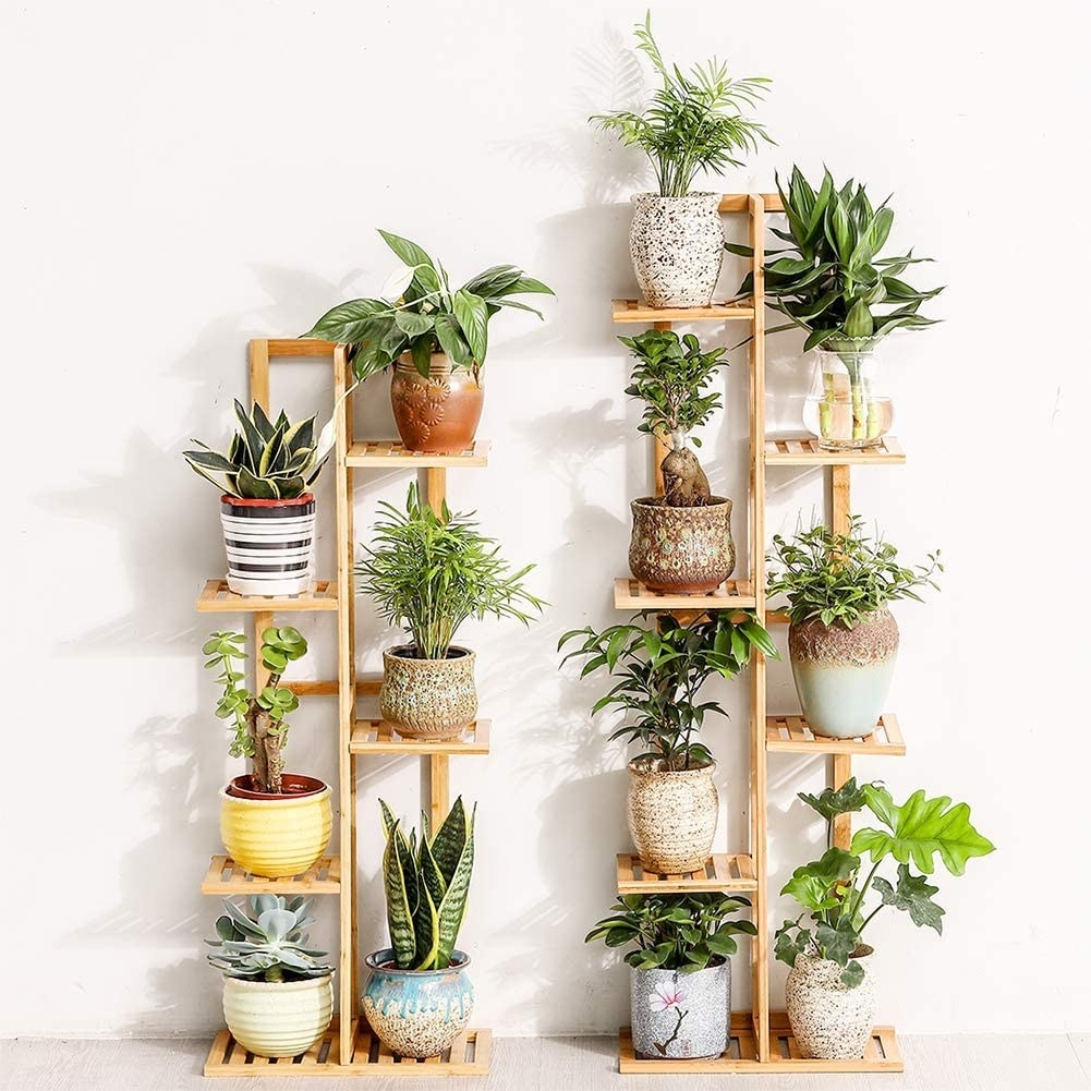 Bamboo stand with five tiers and room for six potted plants