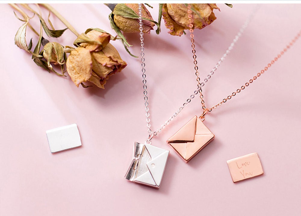 "The envelope-shaped pendant with a separate letter piece inside that reads ""I love you"""