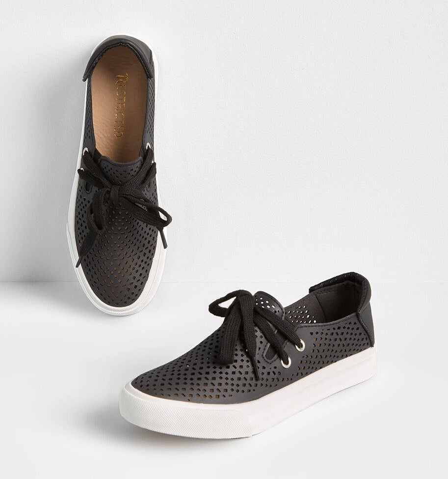 Black faux-leather cut-out sneakers with a slip-on style and laces across the top