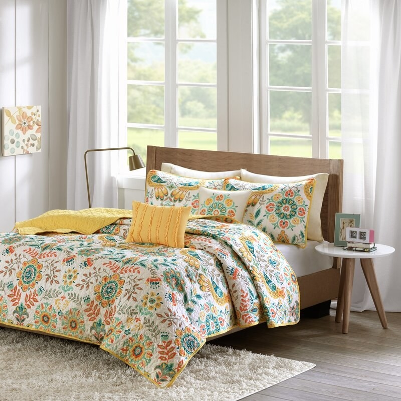 Bungalow Rose's Maxeys quilt with bright floral pattern in tons of colors