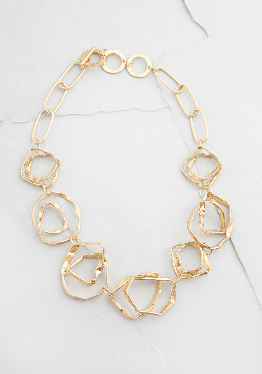 Gold necklace with crinkled, geometric links all around