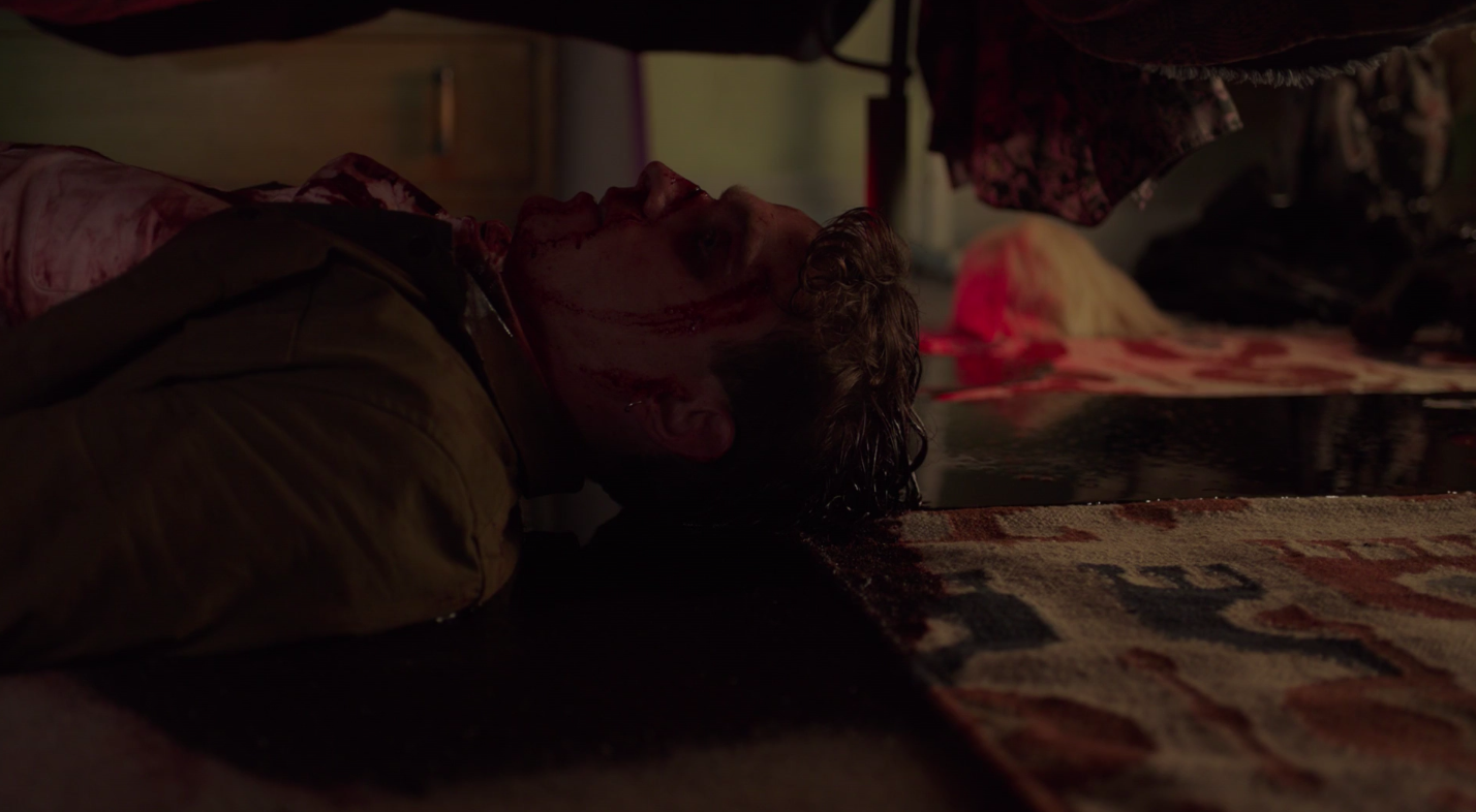 A screen grab of Arabella's rapist bleeding out under her bed