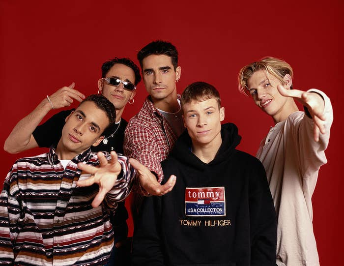 Photo of the Backstreet Boys up against a red background in the mid-'90s