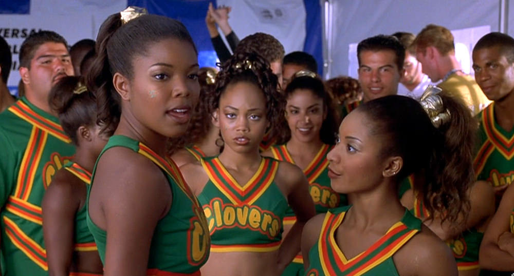 """A screenshot from """"Bring It On"""" of Gabrielle Union-Wade alongside her fellow Clovers cheerleaders"""