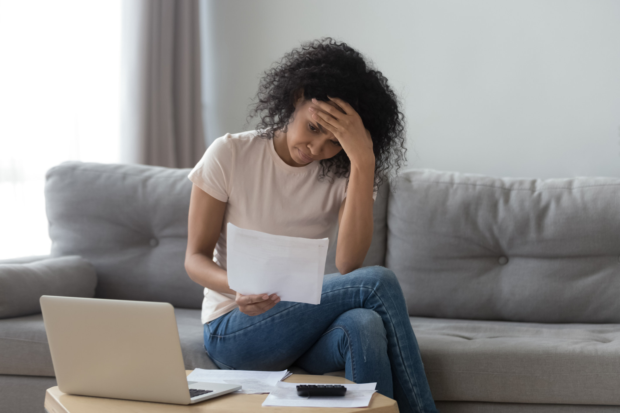 Stressed woman reading a piece of paper
