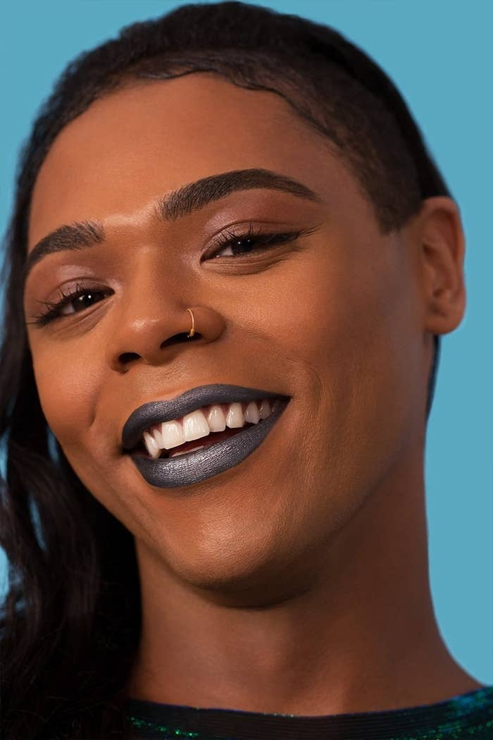 a model smiling and wearing the liquid lip