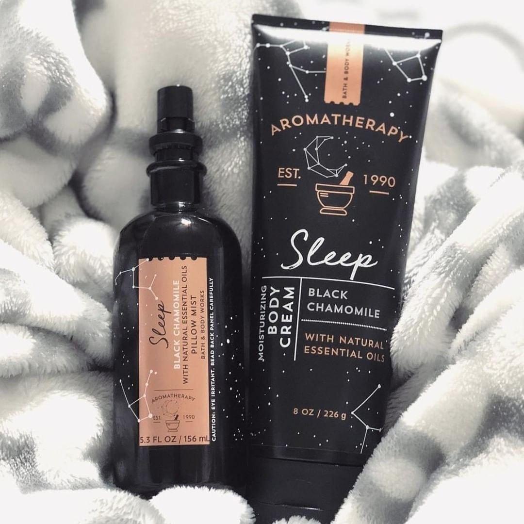 "black pillow spray and body cream labeled ""sleep black chamomile"""
