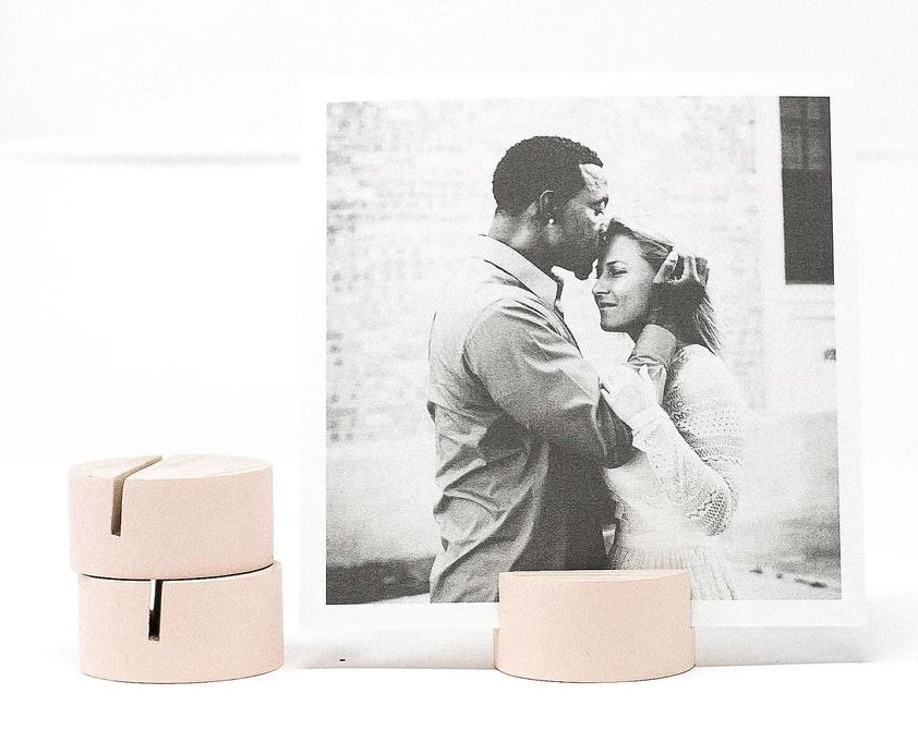 pink block holding up a black and white photo