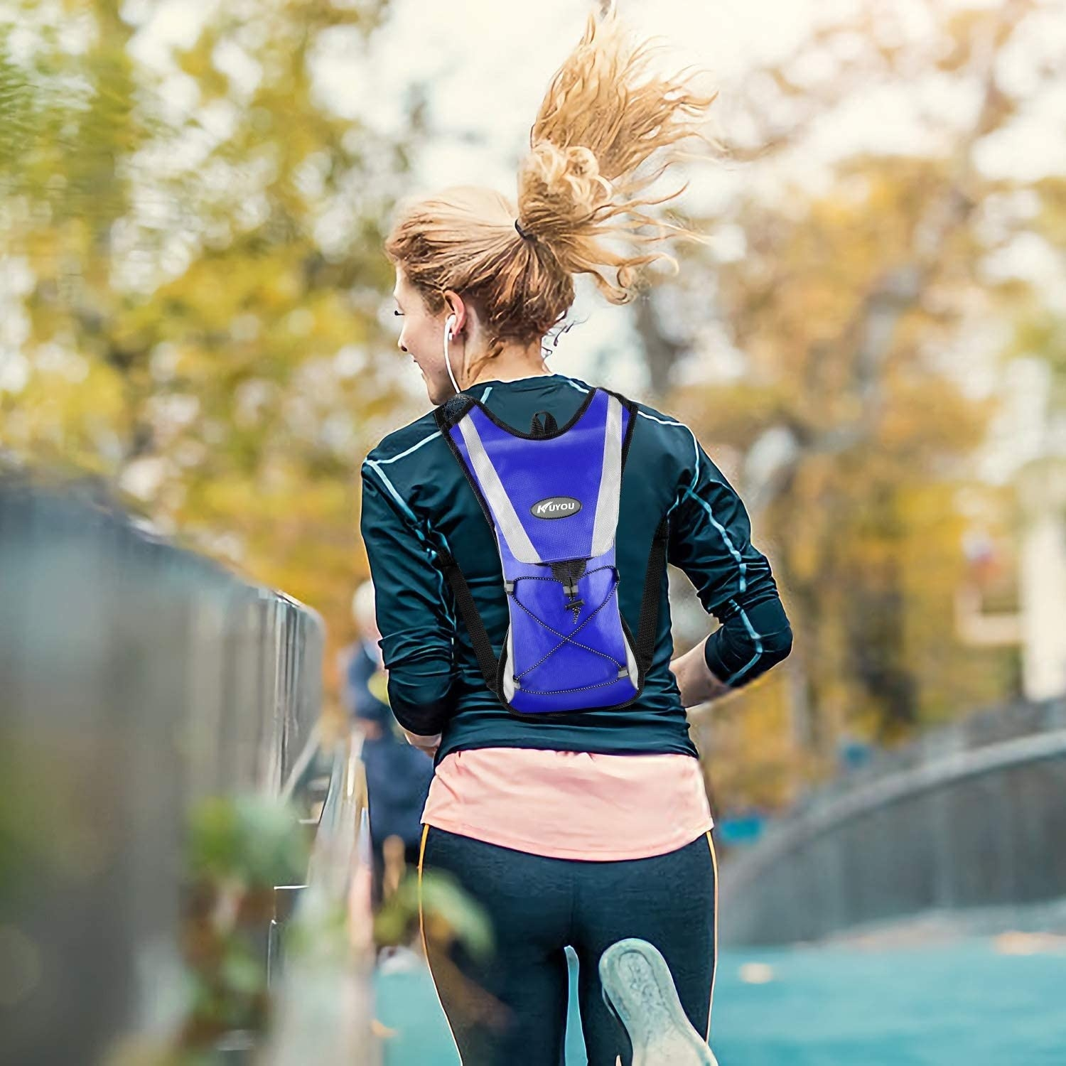 Model running with a blue hydration backpack