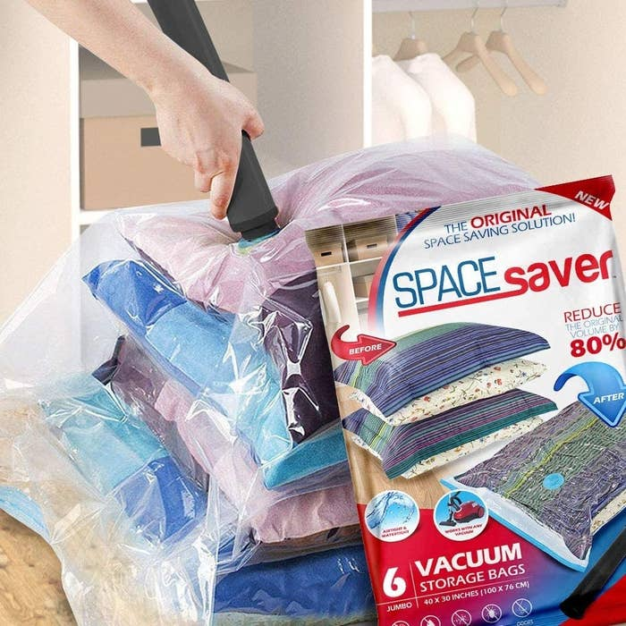 Hands vacuuming air out of a storage bag, plus the packaging of the jumbo bags