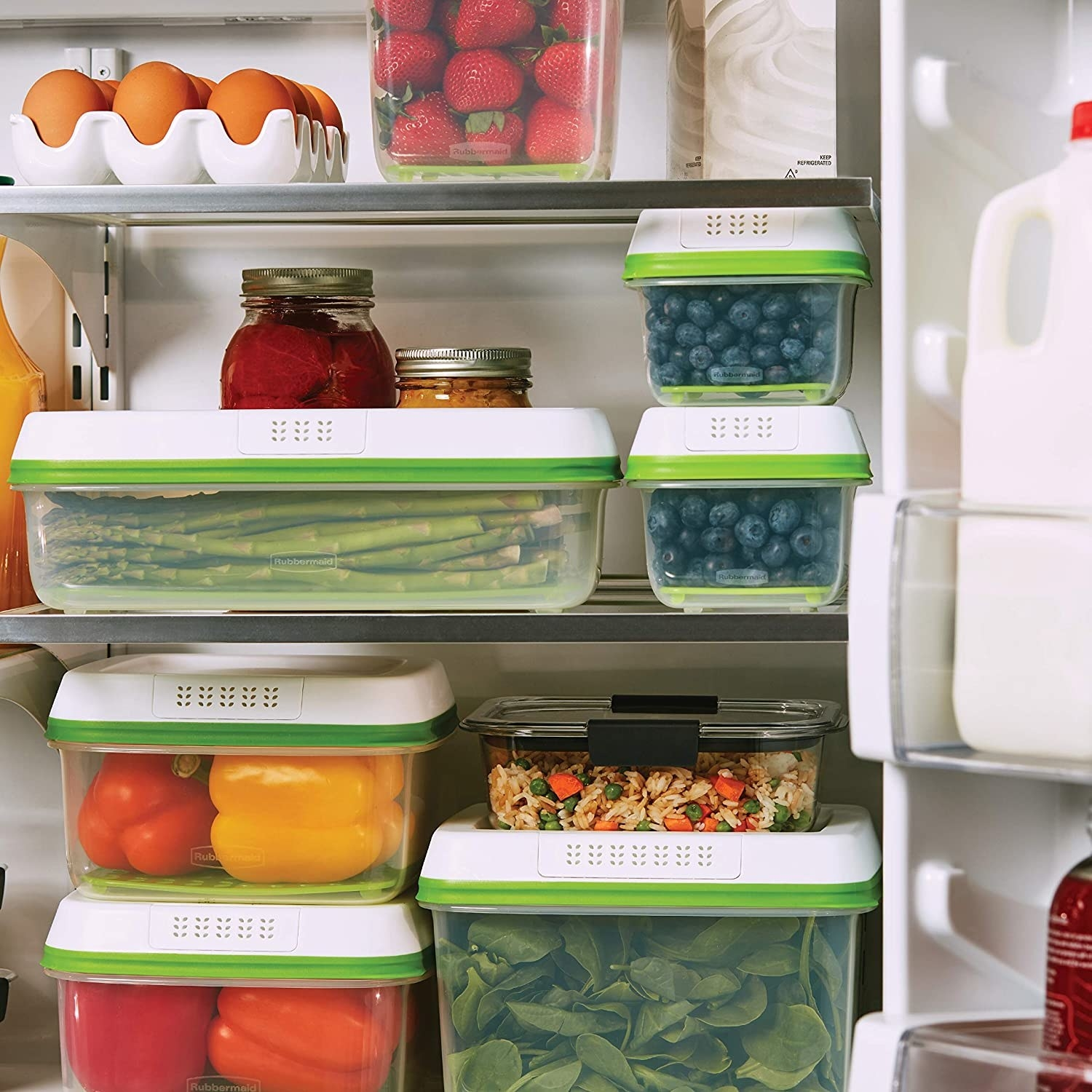 The containers filled with vegetables and fruit inside a refrigerator