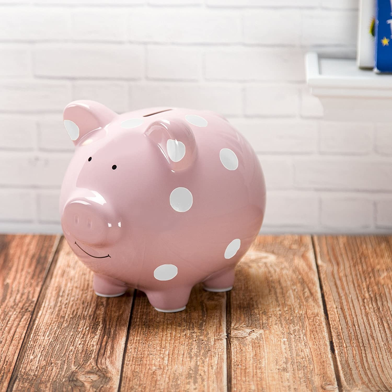 The pink piggy bank with a slot on top for adding money
