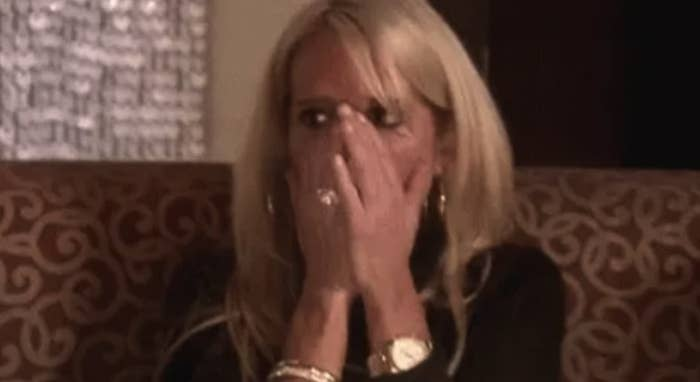 Random woman who's covering her mouth in shock