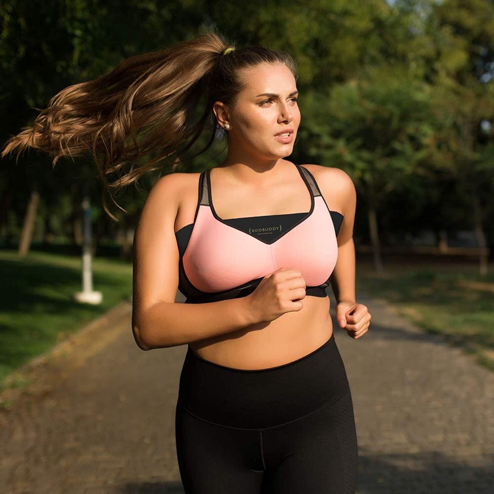 Model running while wearing the band under her sports bra