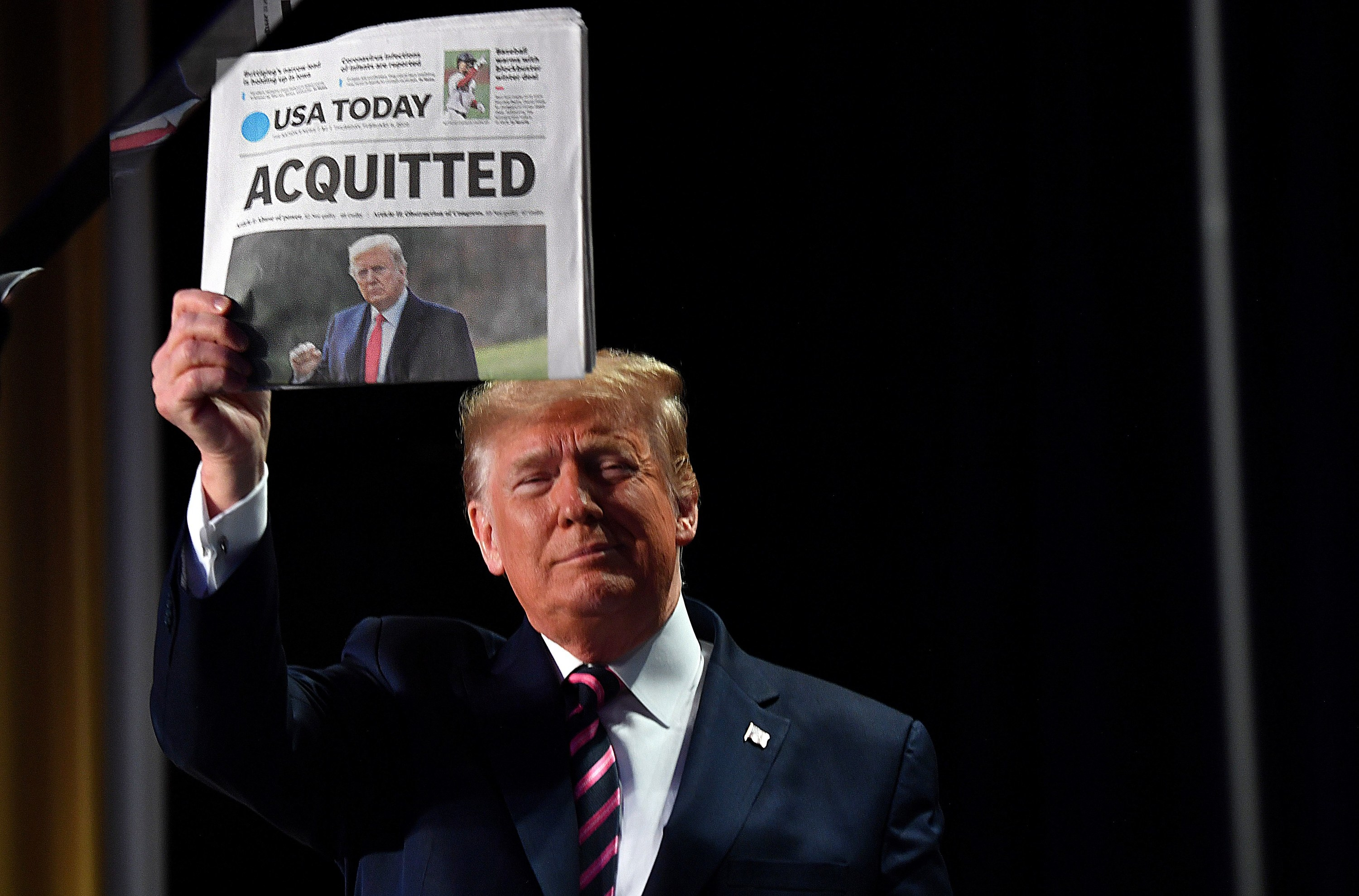 "Trump holding USA Today with the headline ""Acquitted"""