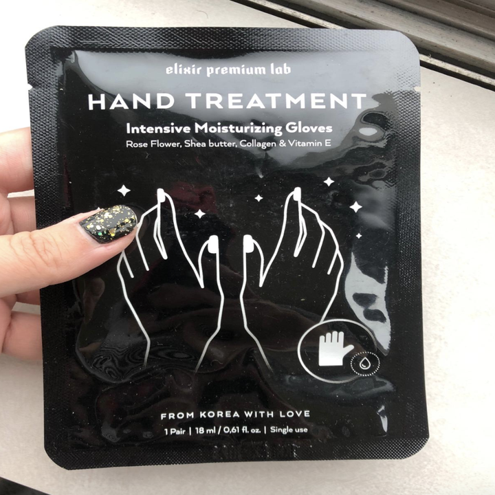 """Reviewer holds black packaging that says """"hand treatment"""""""