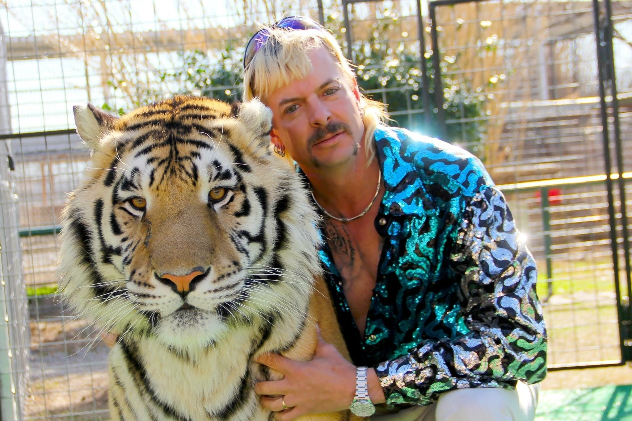 The Tiger King posing with a tiger