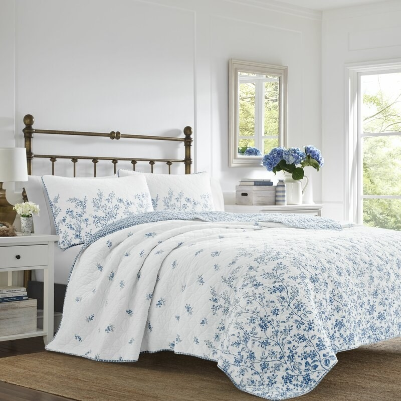 Laura Ashley's reversible quilt with a white and blue floral design