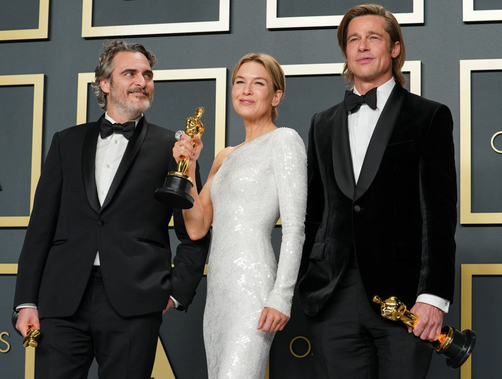 Brad Pitt, Renee Zellweger, and Joaquin Phoenix stand with their Oscars