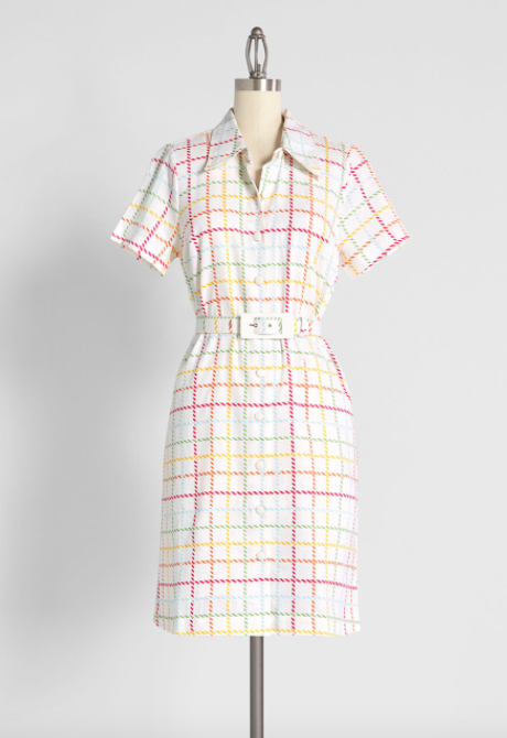 A rainbow striped short-sleeve dress with a cinched belt at the waist line