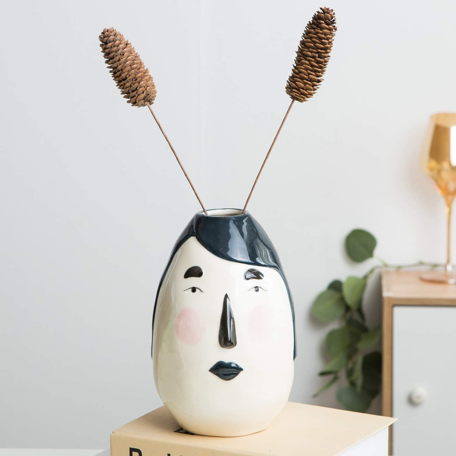 Black and white oval vase with abstract human face