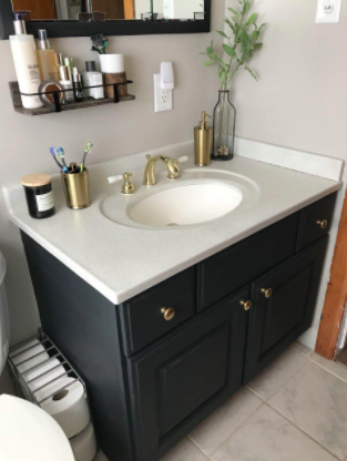 Reviewer pic of transformed bathroom vanity with the help of the spray paint